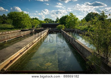Sedimentation Tanks At Abandoned Sewage Treatment Plant