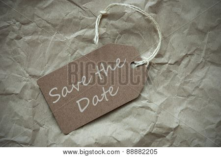 Beige Label With Save The Date Paper Background