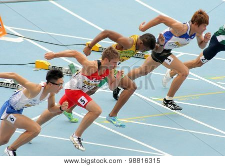 BARCELONA - JULY, 10: Competitors on start of 110m men hurdles during the 20th World Junior Athletics Championships at the Stadium on July 10, 2012 in Barcelona, Spain