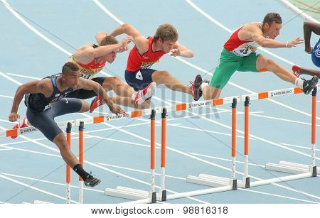 BARCELONA - JULY, 10: Competitors of 110 meters hurdles during the 20th World Junior Athletics Championships at the Stadium on July 10, 2012 in Barcelona, Spain