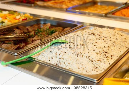 Rice and meat in self-service restaurant, close-up