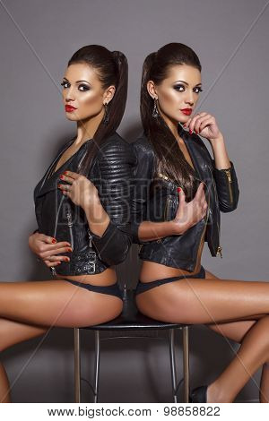 Beautiful Woman With Dark Straight Hair And Red Lips,wearing Leather Jacket,