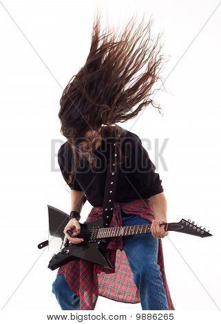 Headbanging kytarista