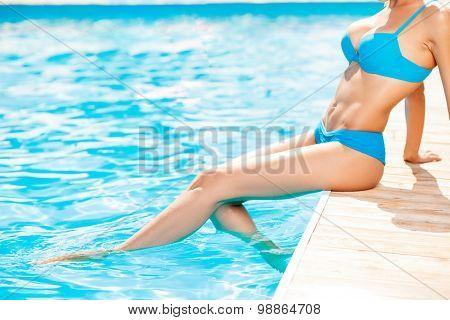 Pretty young healthy woman is getting suntan