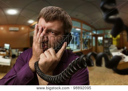 Man speaks on the phone poster