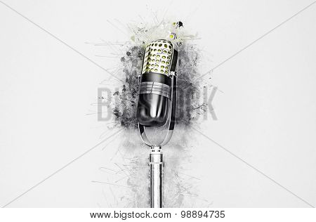 Artistic closeup of microphone surrounded by paint splatter.