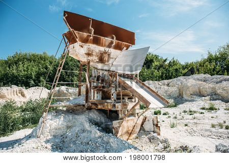 Equipment for sorting and loading ore in a quarry. Construction site in mining chalk quarry