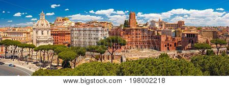 Panoramic view with ancient ruins of Trajan Forum, Market, Trajan Column and church Most Holy Name of Mary in sunny day, Rome, Italy