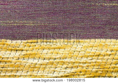 Texture Of Purple And Yellow Fabric Of Polyester
