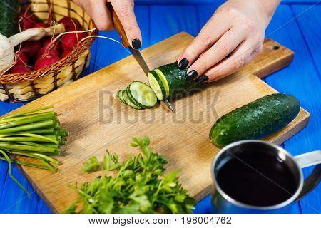 Woman Hands Cutting Fresh Crunchy Cucumber On Cutting Board With