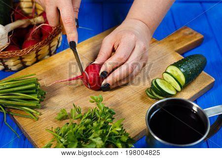 Woman Hands Cutting Fresh Crunchy Radish On Cutting Board With C