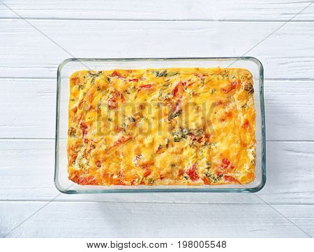 Baking tray with delicious turkey casserole on white wooden table