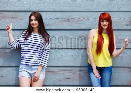 Two Beautiful Young Women In Bright Casual Clothes Posing Outdoo