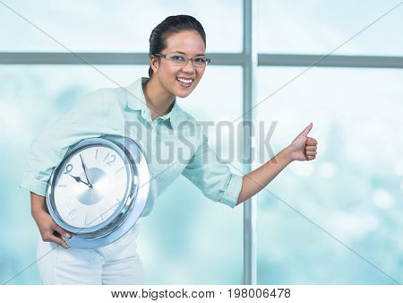 Digital composite of Woman holding clock in front of windows