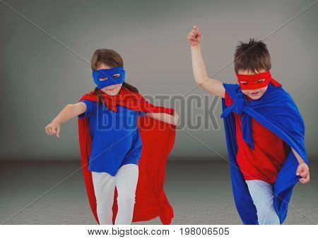 Digital composite of Superhero kids with blank grey background