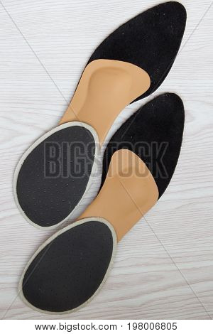 Two Pairs Of Conventional Insoles And One Pair Of Orthopedic Insoles. Top View.