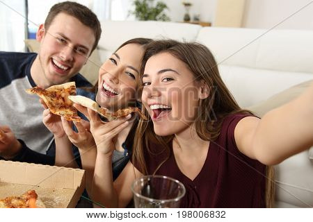 Friends Taking Selfies And Eating Pizza