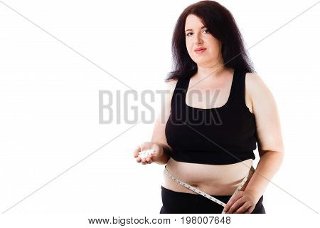 Young Overweight Smiling Woman With Measuring Tape Around Her Wa