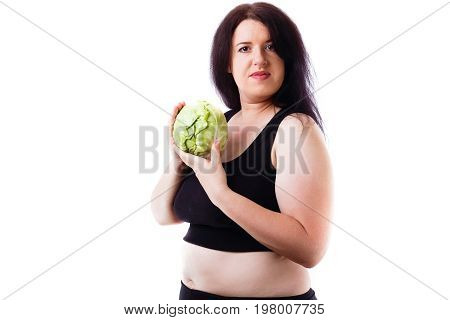 Portrait Of Young Overweight Woman With Cabbage In Hands.