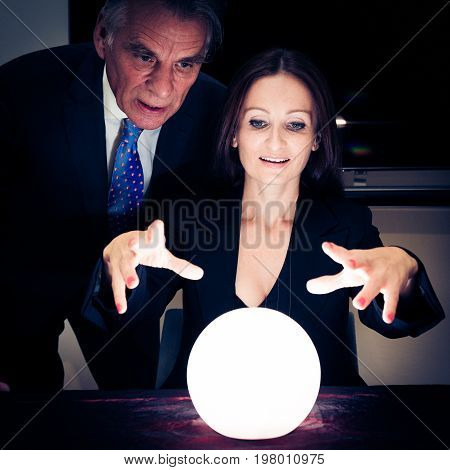 this manager is consulting a fortune teller for advice on which way to steer the company and what the future will bring.