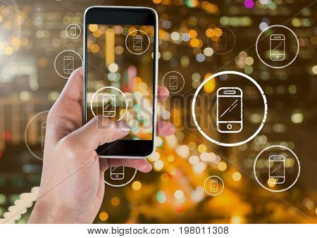 Digital composite of Holding phone and Phone icons over city