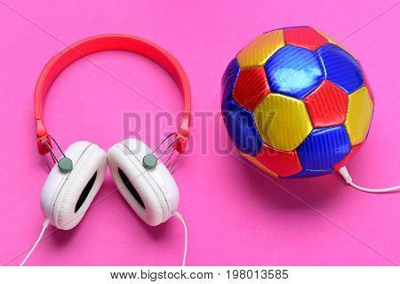 Headset For Music Near Soccer Ball. Music And Sports Equipment