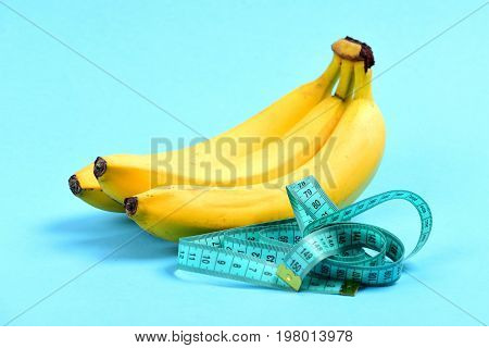 Tape For Measuring In Cyan Color And Bunch Of Bananas