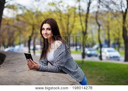 Young Pretty Stylish Smiling Woman Reading Message On Smart Phon
