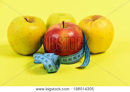 Measuring Tape Or Flexible Ruler In Blue Color And Apples