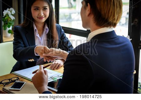 Smart Business Connoisseurs Are Meeting And Working Hand In Hand With Asian Business Woman In Office