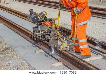 Tramway Track Construction Worker With Rail Grinding Machine 2