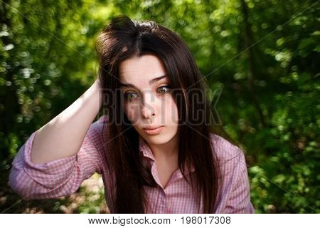 Portrait Of Attractive Young Pensive Perplexed Woman Face Close