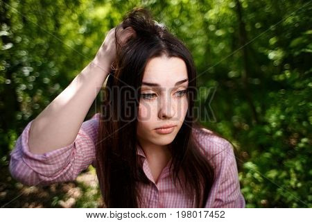 Portrait Of Attractive Young Hesitant Perplexed Woman  Face Clos