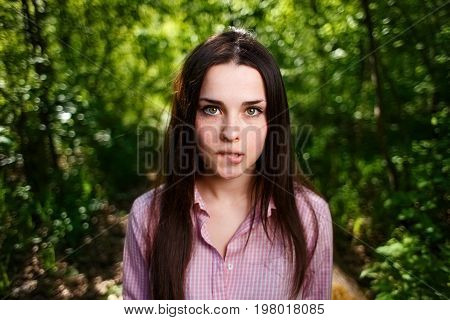 Portrait Of Timid, Shy Cute Young Woman Biting Lips
