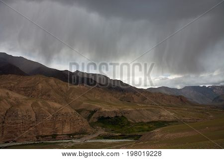 Storm cloud and rain clouds over the mountains Tien-Shan Kyrgyzstan