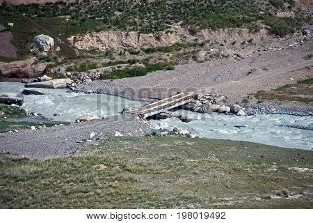 The road and the road bridge over the mountain river Tien Shan Kyrgyzstan