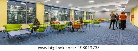 Banner view of spacious university interior with lounge area in modern style