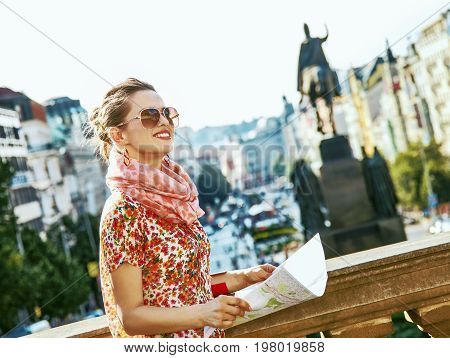 The spirit of old Europe in Prague. smiling young woman on Vaclavske namesti in Prague Czech Republic sightseeing poster