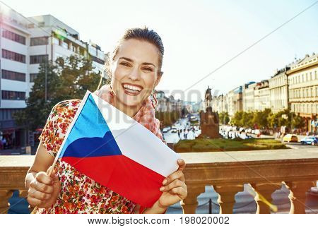 Smiling Woman On Vaclavske Namesti In Prague Showing Flag
