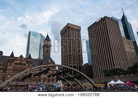 TORONTO - July 19 2015: Nathan Phillips Square an urban plaza in Toronto Ontario Canada. It forms the forecourt to Toronto City Hall or New City Hall.
