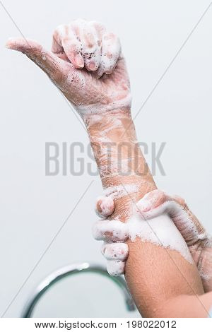 Nurse perform surgical hand washing, Preparation to the operating room. Closed-up of the hands.