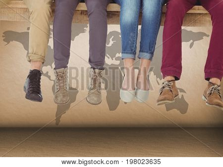 Digital composite of Group of people's legs sitting on wooden plank in front of world map
