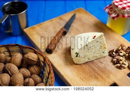 Piece Of Homemade Spicy Cheese With Walnuts,mug Of Homemade Wine