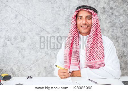 Arab business man sitting at a desk in the office