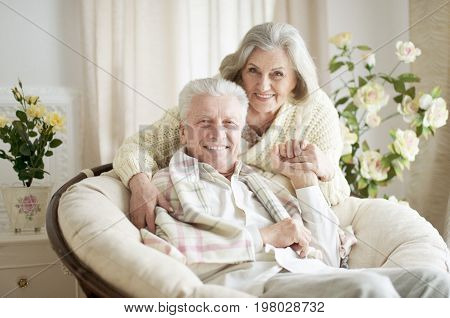 Portrait of happy senior couple resting together