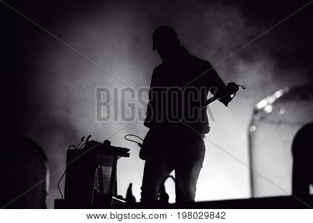 Silhouette Of A Guitar Player In Stage Lights