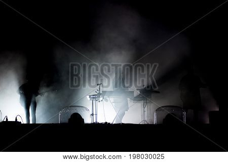 Live Concert. Silhouette Of Artists On The Stage