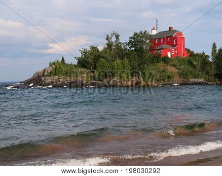 The red Marquette Harbor Lighthouse overlooks Lake Superior on the northern shore of the upper peninsula of Michigan and dates back to 1866. Marquette Michigan.