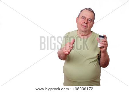 Portrait Of Old Overweight Man With Pills In Hand And Thumb Up G