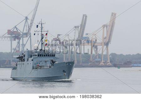 MINEHUNTER - Estonian warship against the background of the port of Swinoujscie